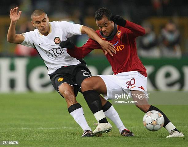 Danny Simpson of Manchester United clashes with Mancini of AS Roma during the UEFA Champions League match between AS Roma and Manchester United at...