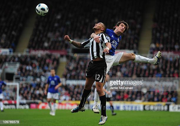 Danny Simpson of Newcastle battles with Leighton Baines of Everton during the Barclays Premier League match between Newcastle United and Everton at...