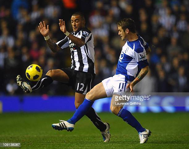 Danny Simpson of Newcastle United battles for the ball with David Bentley of Birmingham City during the Barclays Premier League match between...