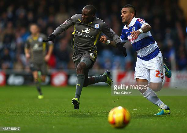 Danny Simpson of Queens Park Rangers battles for the ball with Daniel Drinkwater of Leicester City during the Sky Bet Championship match between...