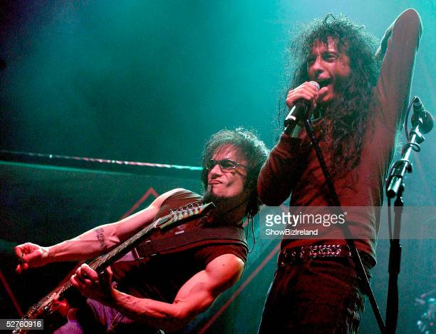 Danny Spitz and Joey Belladonna of Anthrax perform on stage during their 20th anniversary tour concert on May 4 2005 in Dublin Ireland