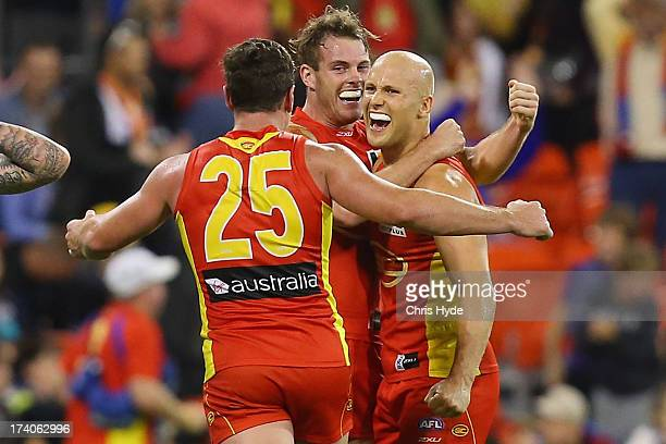 Danny Stanley Luke Russell and Gary Ablett of the Suns celebrate winning the round 17 AFL match between the Gold Coast Suns and the Collingwood...