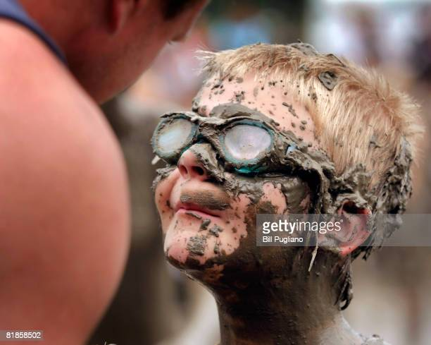 Danny Sullivan age 8 of Redford Michigan talks to his father at the annual Mud Day celebration July 8 2008 in Westland Michigan Sponsored by the...