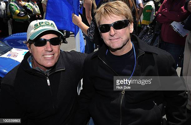 Danny Sullivan former winner of the Indy 500 and Wayne Rainey former motorcyle world champion on the grid during the American Le Mans Series Monterey...