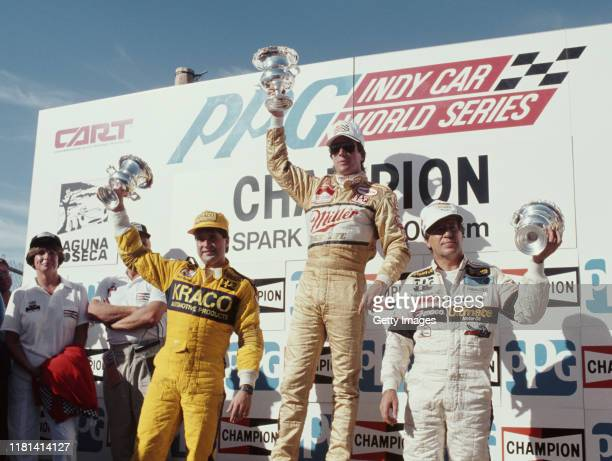 Danny Sullivan of the United States and driver of the Team Penske Miller High Life Penske PC-17 Chevrolet 265A celebrates alongside second placed...