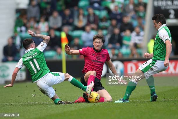 Danny Swanson of Hibernian vies with Jack Hendry of Celtic during the Ladbrokes Scottish Premiership match between Hibernian and Celtic at Easter...