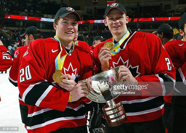 Danny Syvret and Corey Perry of Team Canada celebrate their gold medal win after beating Team Russia during the gold medal game at the World Jr....