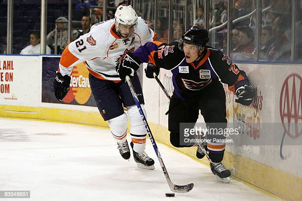 Danny Syvret of the Philadelphia Phantoms is challenged for possession of the puck by Jeremy Colliton of the Bridgeport Sound Tigers during the first...