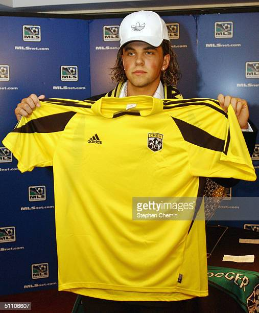 Danny Szetela of Clifton New Jersey wears an Adidas hat as he holds a Columbus Crew soccer jersey July 22 2004 in New York City Szetela was drafted...