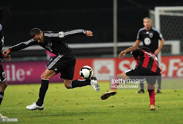 Danny Szetela of US team DC United controls the ball in front of Devon Jamerson of Trinidad and Tobago team San Juan Jabloteh during a Group B...