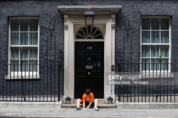 Danny the son of Labour MP Jess Phillips on the steps of Downing Street after he was left there by his mother as a symbol of protest over schools...