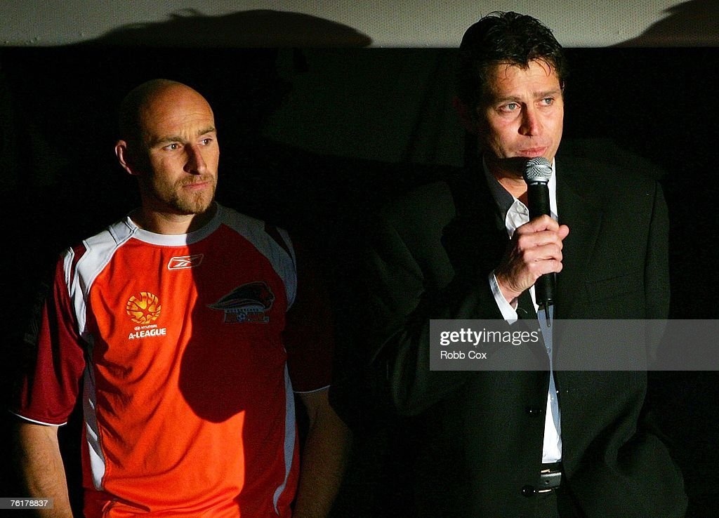 Danny Tiatto of Queensland Roar looks on as Queensland Roar coach Frank Farina addresses the audience during the 2007/2008 A-League Season Launch at The Entertainment Quarter on August 20, 2007 in Sydney, Australia.