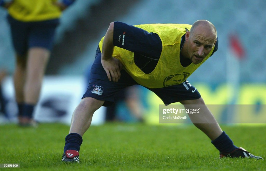 Danny Tiatto of the Socceroos stretches during Australian Socceroos training at Aussie Stadium, May 20, 2004 in Sydney Australia.