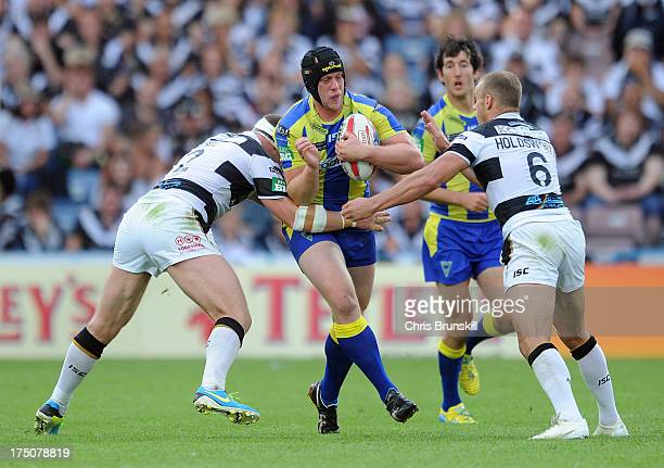 Danny Tickle of Hull FC tackles Chris Hill of Warrington Wolves during the Tetley's Challenge Cup Semi Final between Hull FC and Warrington Wolves at...