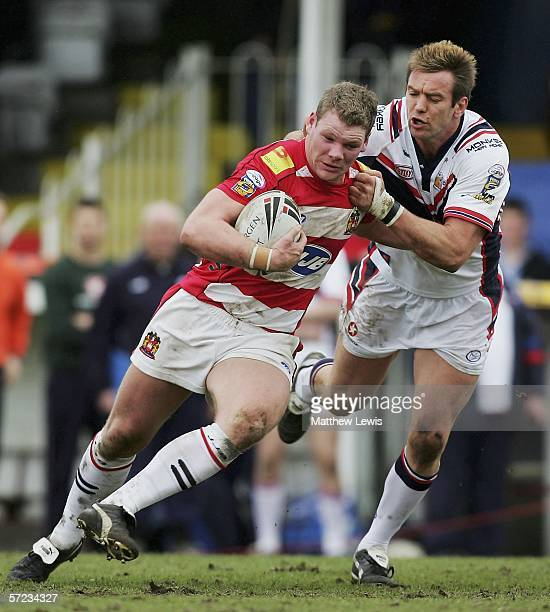 Danny Tickle of Wigan is tackled by Ned Catic of Wakefield during the Powergen Challenge Cup 4th Round match between Wakefield Trinity Wildcats and...