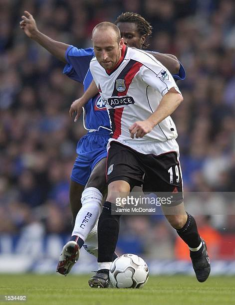 Danny Tito of Man City holds off Aliou Cisse of Birmingham during the FA Barclaycard Premiership match between Birmingham City and Manchester City at...