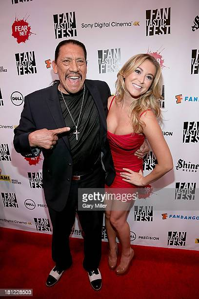 Danny Trejo and Alexa Vega pose on the red carpet for the world premiere of 'Machete Kills' during the opening night of Fantastic Fest at the Alamo...