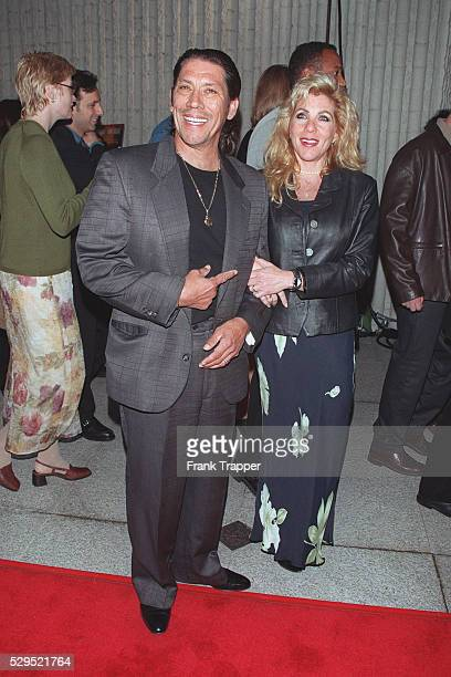 Danny Trejo and his wife arrive at the Avco Cinerama Center