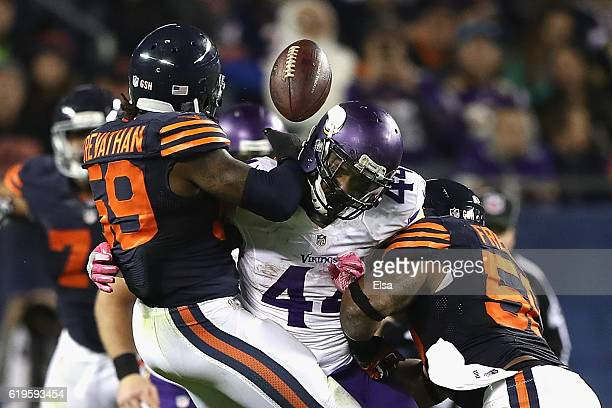 Danny Trevathan and Jerrell Freeman of the Chicago Bears break up a pass intended for Matt Asiata of the Minnesota Vikings during the fourth quarter...