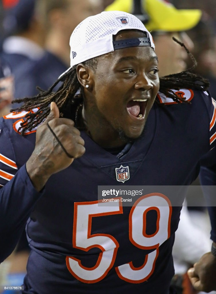 Danny Trevathan #59 of the Chicago Bears celebrates a teammates play against the Cleveland Browns during a preseason game at Soldier Field on August 31, 2017 in Chicago, Illinois.