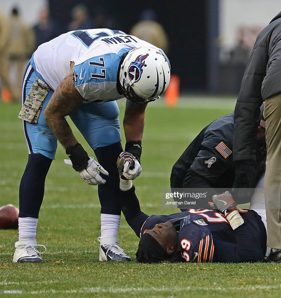 Danny Trevathan #59 of the Chicago Bears Illinois State Redbirds conforted by Taylor Lewan #77 of the Tennessee Titans after suffering a knee injury at Soldier Field on November 27, 2016 in Chicago, Illinois. The Titans defeated the Bears 27-21.