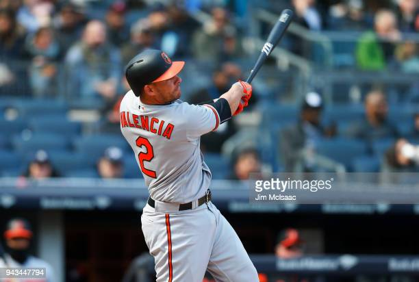 Danny Valencia of the Baltimore Orioles follows through on a fifth inning two run home run against the New York Yankees at Yankee Stadium on April 8...