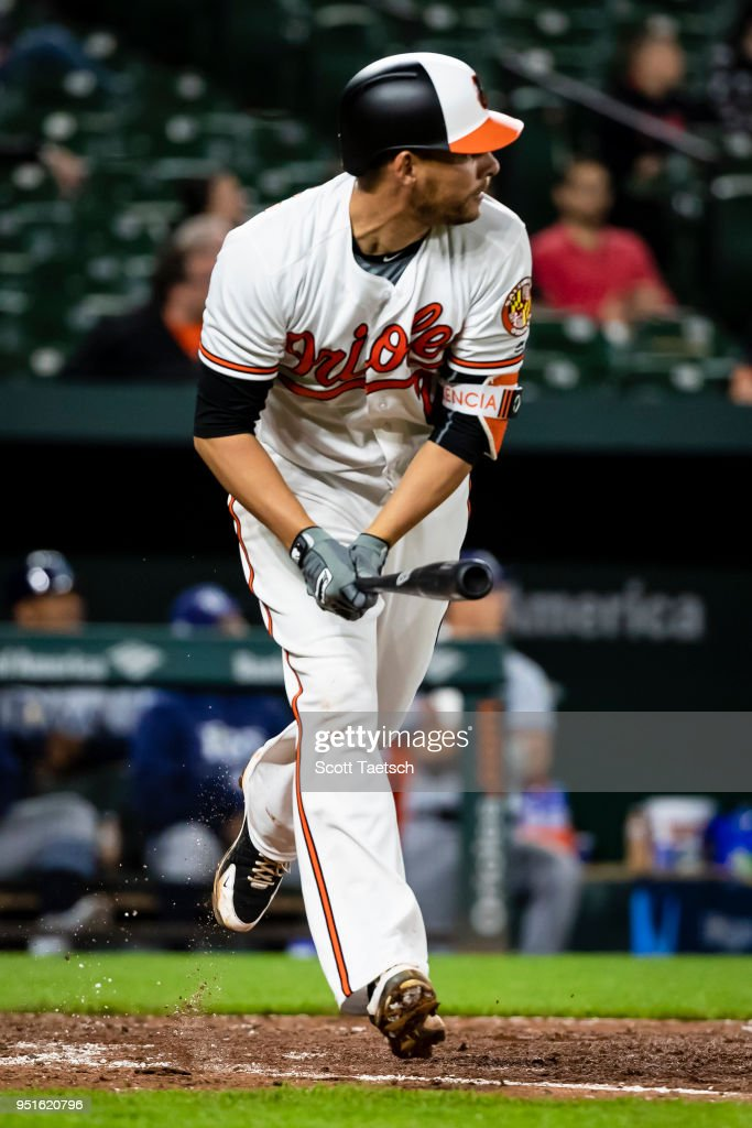 Danny Valencia #2 of the Baltimore Orioles hits a solo home run during the eighth inning against the Tampa Bay Rays at Oriole Park at Camden Yards on April 26, 2018 in Baltimore, Maryland.