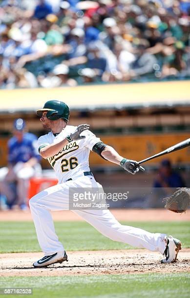 Danny Valencia of the Oakland Athletics bats during the game against the Toronto Blue Jays at the Oakland Coliseum on July 17 2016 in Oakland...