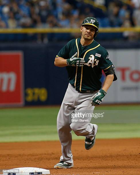 Danny Valencia of the Oakland Athletics gestures as he rounds third base after hitting a tworun home run off of pitcher Steven Geltz of the Tampa Bay...