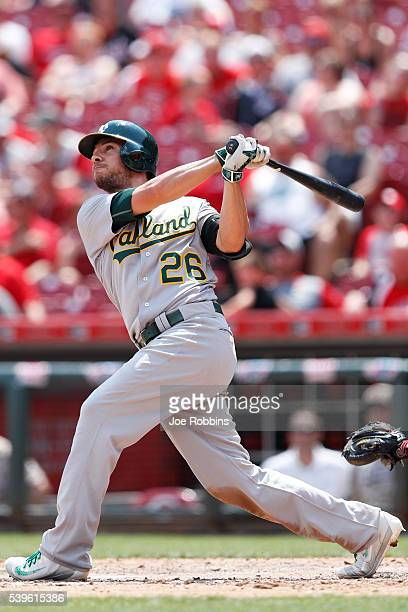 Danny Valencia of the Oakland Athletics hits a solo home run against the Cincinnati Reds in the eighth inning of the game at Great American Ball Park...