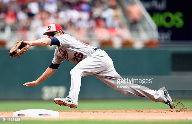 Danny Valencia of the Oakland Athletics makes a play at third base to field the ball hit by Brian Dozier of the Minnesota Twins during the fourth...