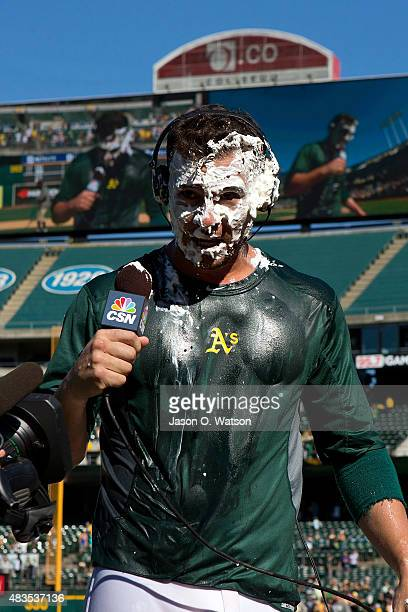 Danny Valencia of the Oakland Athletics reacts after getting hit with a pie and Gatorade after the game against the Houston Astros at Oco Coliseum on...