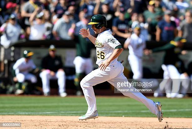 Danny Valencia of the Oakland Athletics rounds third base to score the winning run against the Boston Red Sox in the bottom of the ninth inning at...