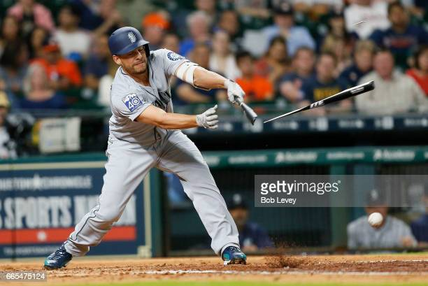 Danny Valencia of the Seattle Mariners breaks his bat as he grounds out to Yuli Gurriel of the Houston Astros in the fourth inning at Minute Maid...