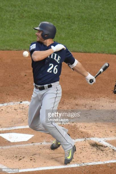 Danny Valencia of the Seattle Mariners foul tips the ball during a baseball game against the Washington Nationals at Nationals Park on May 24 2017 in...