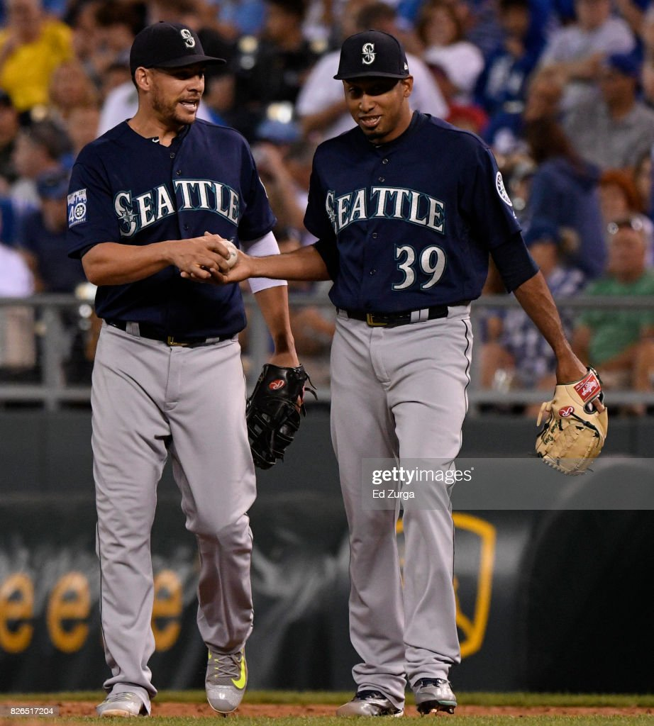 Danny Valencia #26 of the Seattle Mariners hands over the ball to Edwin Diaz #39 of the Seattle Mariners as they celebrate a 5-2 win over the Kansas City Royals at Kauffman Stadium on August 4, 2017 in Kansas City, Missouri.