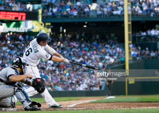 Danny Valencia of the Seattle Mariners hits a single to bring in Nelson Cruz to score in the third inning against the New York Yankees at Safeco...