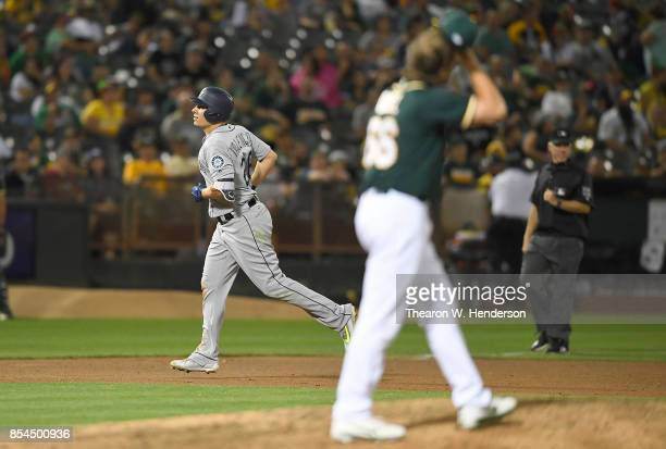 Danny Valencia of the Seattle Mariners trots around the base after hitting a threerun homer off of Ryan Dull of the Oakland Athletics in the top of...