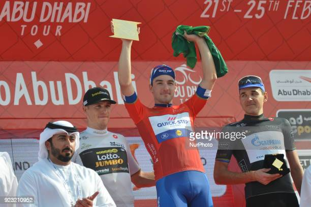 Danny van Poppel of The Netherlands in White Best Young Rider Jersey, Elia Viviani of Italy in Red Leader Jersey and Nikolay Trusov of Russia in...