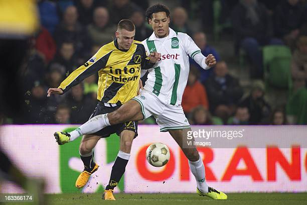 Danny Verbeek of NAC Breda Virgil van Dijk of FC Groningen during the Dutch Eredivisie match between FC Groningen and NAC Breda at the Euroborg on...