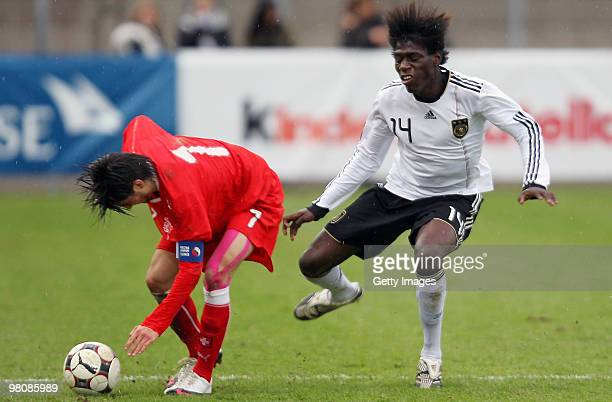 Danny Vieira Da Costa of Germany fights for the Ball with Mike Kleiber of Switzerland during the U17 Euro Qualifier match between Switzerland and...