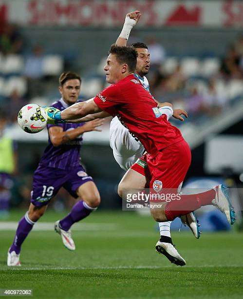 Danny Vukovic of Perth Glory stops a Kosta Barbarouses of Melbourne Victory shot at goal during the round 14 ALeague match between the Melbourne...