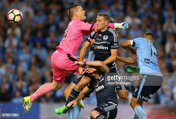 Danny Vukovic of Sydney and Alan Baro of the Victory compete for the ball during the 2017 ALeague Grand Final match between Sydney FC and the...