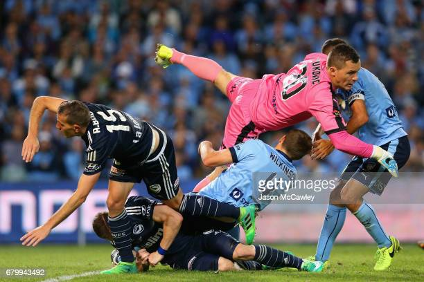 Danny Vukovic of Sydney colides with Alex Wilkinson of Sydney during the 2017 ALeague Grand Final match between Sydney FC and the Melbourne Victory...