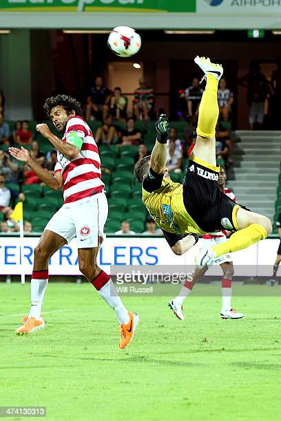 Danny Vukovic of the Glory performs a scissor kick during the round 20 ALeague match between Perth Glory and the Western Sydney Wanderers at nib...