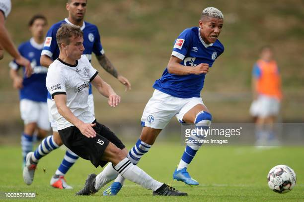 Danny Walkenbach of Schwarz Weiss Essen Amine Harit of Schalke 04 during the Club Friendly match between Schalke 04 v Schwarz Weiss Essen at the...