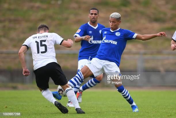 Danny Walkenbach of Schwarz Weiss Essen and Amine Harit of Schalke battle for the ball during the Friendly match between Schwarz Weiss Essen and FC...