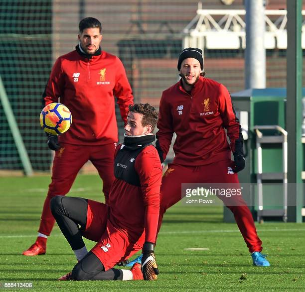 Danny Ward Adam Lallan and Emre Can of Liverpool during a training session at Melwood Training Ground on December 8 2017 in Liverpool England