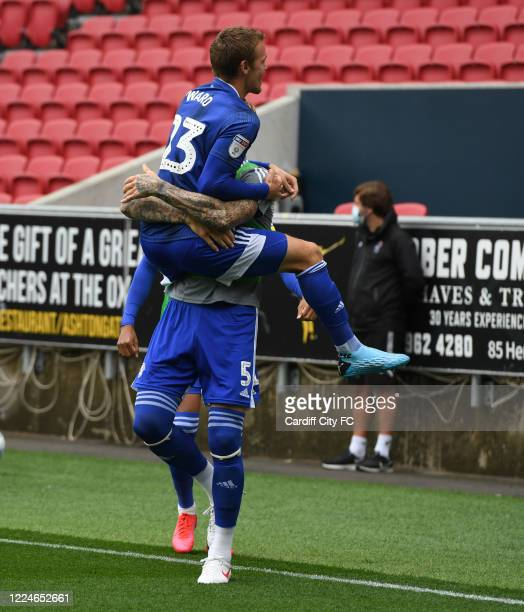 Danny Ward and Aden Flint of Cardiff City FC celebrate during the Sky Bet Championship match between Bristol City and Cardiff City at Ashton Gate on...