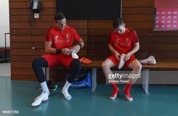 Danny Ward and Andrew Robertson of Liverpool during a training session on the second day back at Melwood Training Ground for the preseason training...
